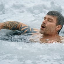 Image of man in ice-cold water.